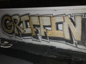 """Graffiti on roof that says """"Griffin"""""""